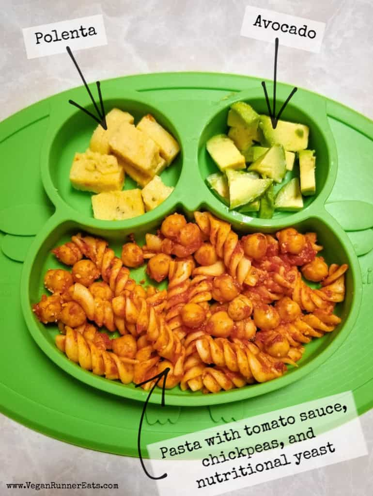 What vegan kids eat for lunch: pasta with chickpeas and tomato sauce, polenta cubes, and avocado.