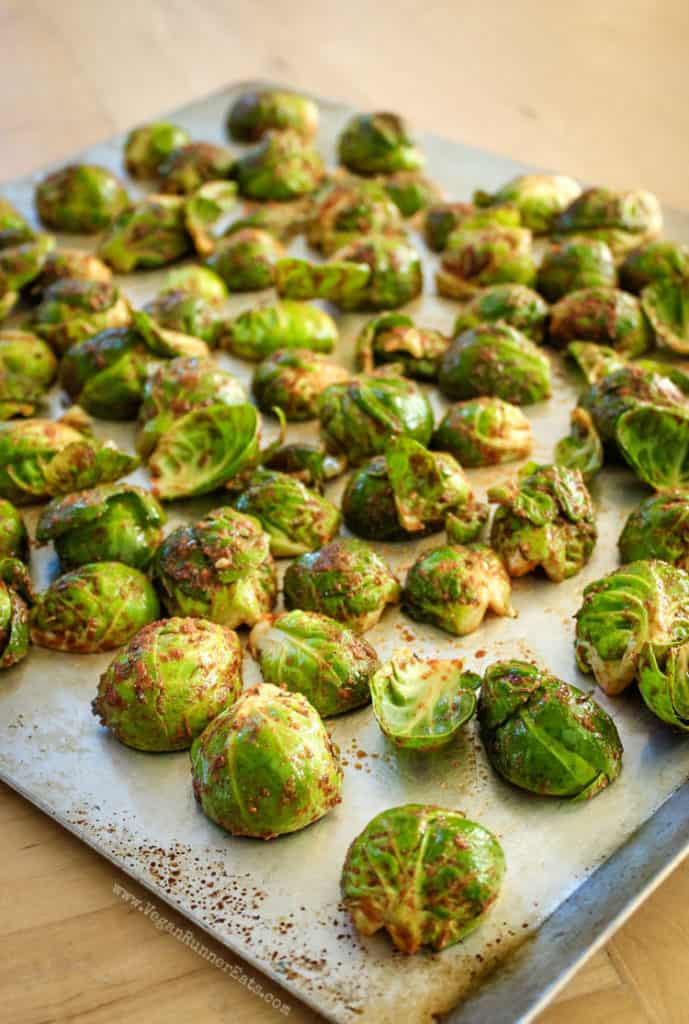 Smoky vegan Brussels sprouts before roasting on a baking sheet