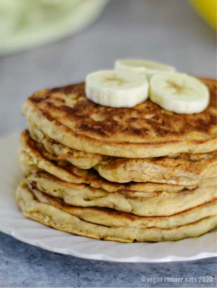 Fluffy vegan pancakes with bananas and chia seeds - an easy dairy free, oil free pancakes recipe with no refined sugar added.