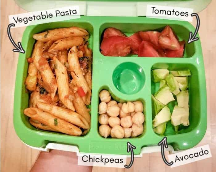 Vegan daycare lunchbox for my toddler, example 1: vegetable pasta with tomato sauce, chickpeas, avocado, sliced tomatoes