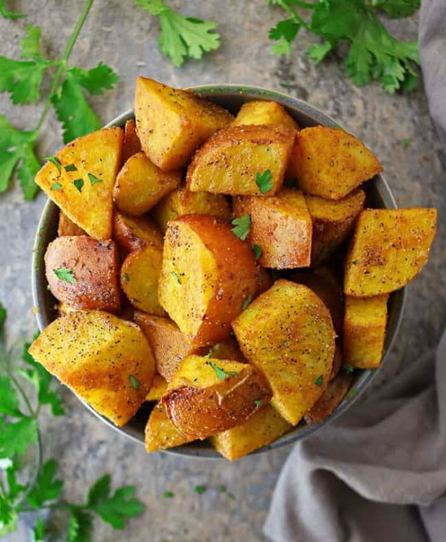 Melt In Your Mouth Spiced Turmeric Potatoes from Savory Spin - - Best Vegan Thanksgiving Recipes