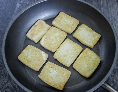 Frying tofu in a skillet