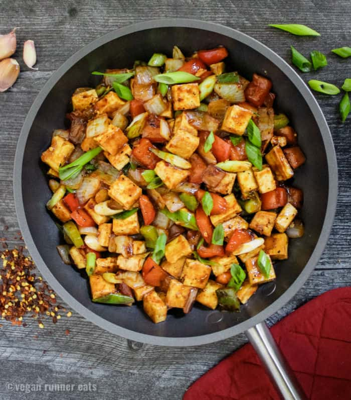 Spicy Chinese style tofu and peppers in easy homemade Szechuan sauce