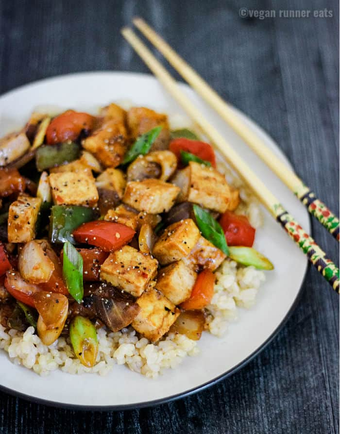 Szechuan style Chinese tofu dish with peppers and onions