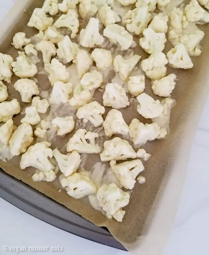 How to arrange breaded cauliflower on a baking tray to make buffalo cauliflower